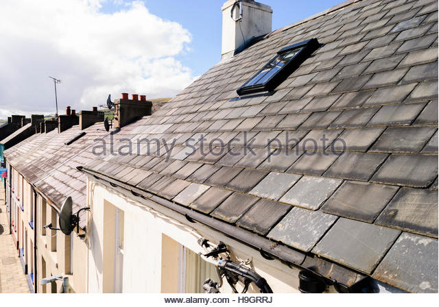 Slate roof tiles tiled stock photos slate roof tiles for Roof terrace flooring
