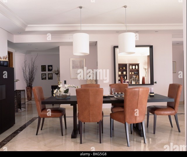 tan leather dining chairs stock photos & tan leather dining chairs