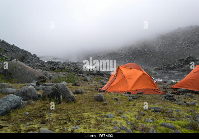 two orange tents on the bank of the rough river - Stock Image & Orange Tents Stock Photos u0026 Orange Tents Stock Images - Alamy