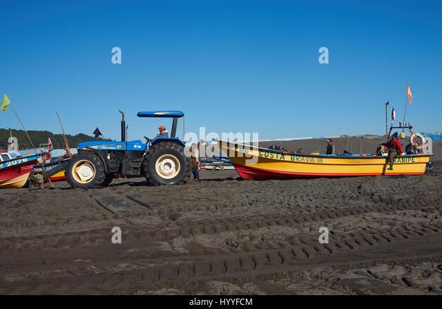 Tractor Pull Boats : Fishermen boat beach drag stock photos