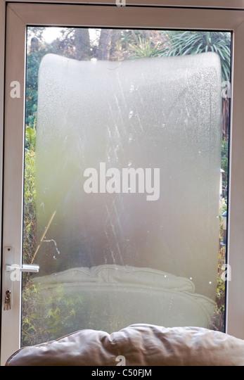 Glass door condensation stock photos glass door condensation damaged upvc sealed unit in door showing condensation between the panes of glass stock image planetlyrics Images