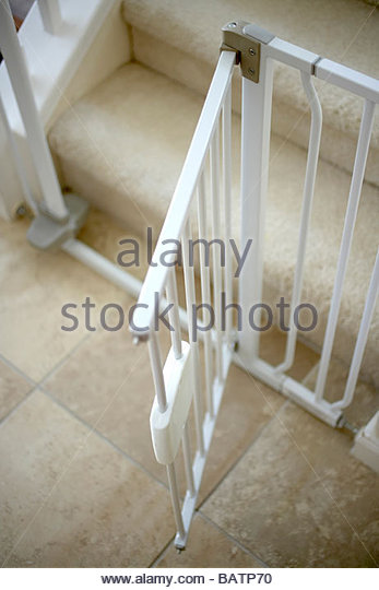Close Up Of Open Childproof Gate At Foot Of Stairs   Stock Image