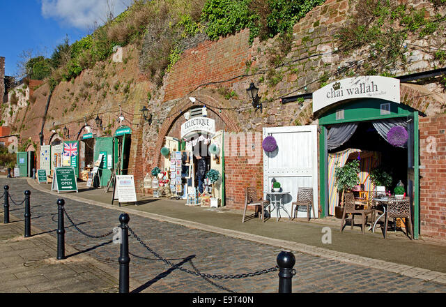 independent traders using old storage sheds as shops along the quay at exeter in devon