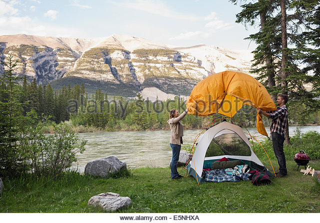 Couple assembling tent at c&site near mountains - Stock Image & Riverside Tent Stock Photos u0026 Riverside Tent Stock Images - Alamy