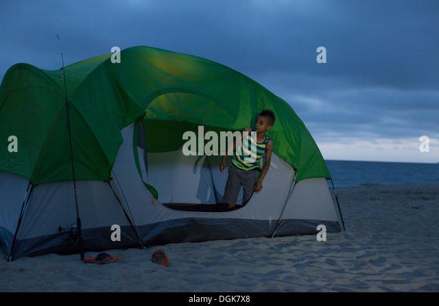 Boy In Tent On Huntington Beach California Usa Stock Image