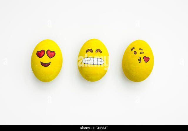 Painted Emoji Easter Eggs In Different Moods And Facial Expressions Such As Kissing Smiling Or