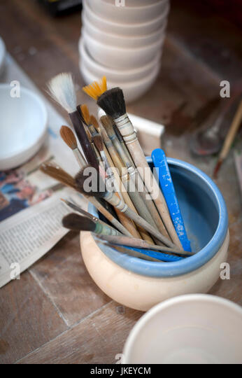 paint brushes at Rene Klohte at  Pottery in Halle-Salle, Germany. - Stock Image