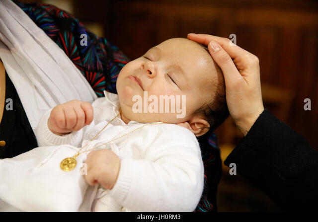 Baptism in a catholic church. France. - Stock Image