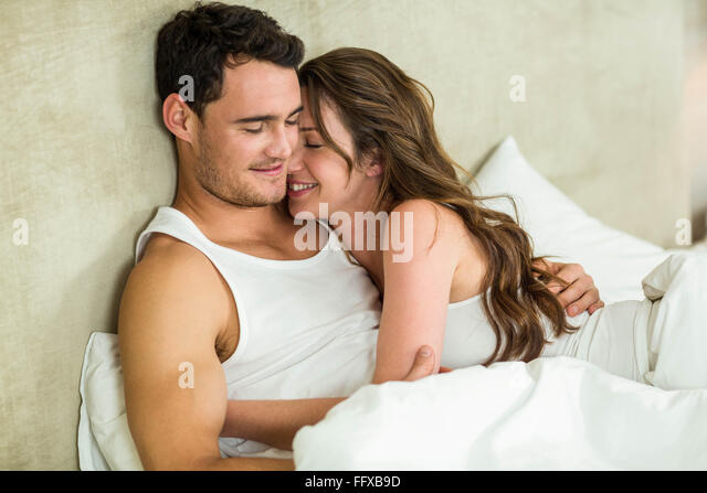 Cozy home blanket couple stock photos cozy home blanket for Love pictures in bed