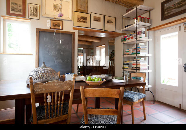 Kitchen Dining Table With Blackboard Message, Antique Chairs And Artwork In  South African Home