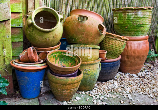 Terracotta tubs stock photos terracotta tubs stock images alamy old and used garden pots and tubs piled up which have gone mossy and lichen covered workwithnaturefo