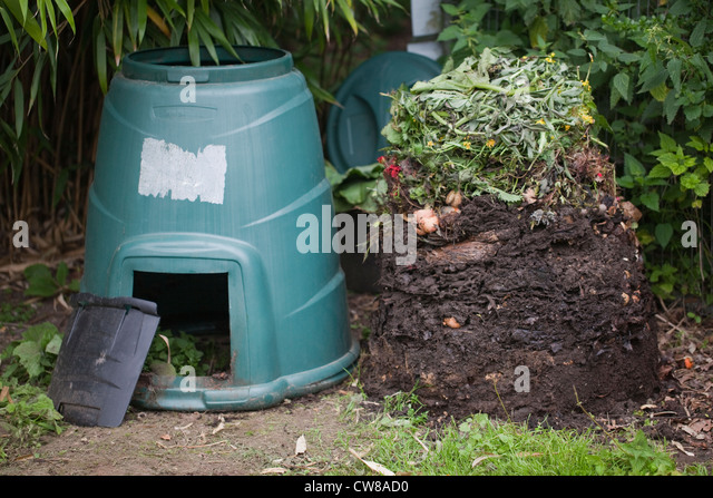 garden composting bin lifted off the collected kitchen and garden vegetation waste to reveal stages
