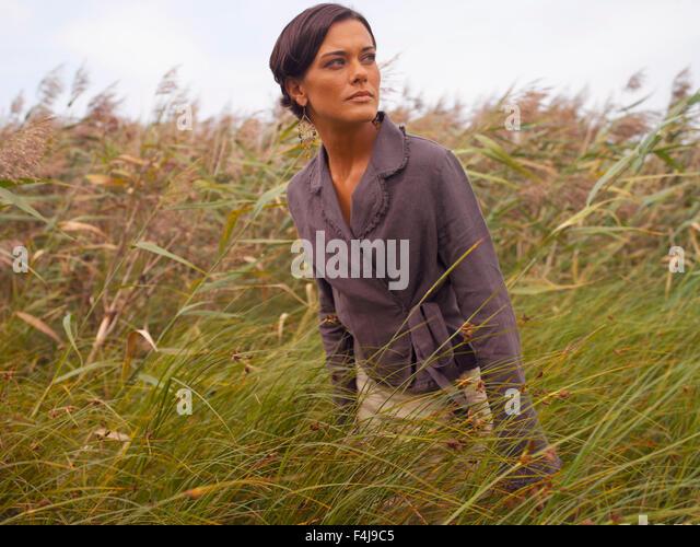 woman walking in grass - photo #30