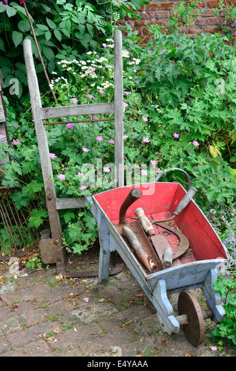 Old wooden wheelbarrow stock photos old wooden for Gardening tools for 6 year old