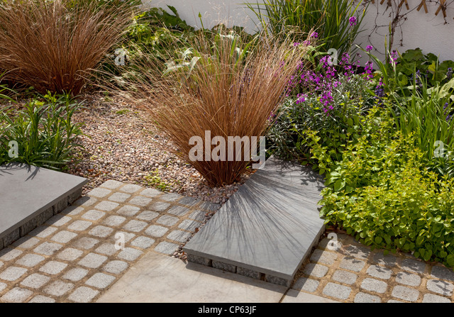 Grasses gravel garden stock photos grasses gravel garden for Contemporary garden grasses