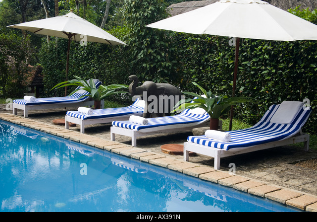 Sun loungers beside a swimming pool Shalimar Spice Garden Resort Hotel Kumily Kerala & Empty Outdoor Swimming Pool Recliners Stock Photos u0026 Empty Outdoor ... islam-shia.org