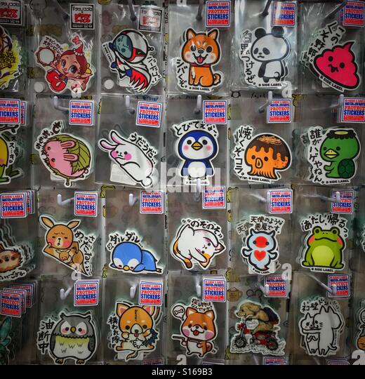 Display of japanese cartoon character badges and stickers stock image