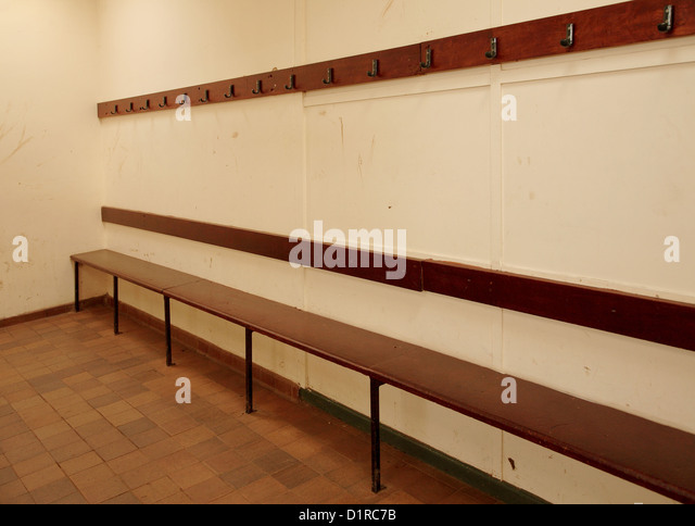 empty locker room bench just after the janitor has cleaned it ready for the next - Locker Room Benches
