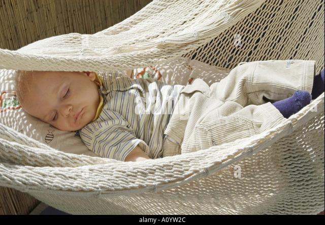 baby sleeping quietly in hammock   stock image baby sleeping in hammock stock photos  u0026 baby sleeping in hammock      rh   alamy