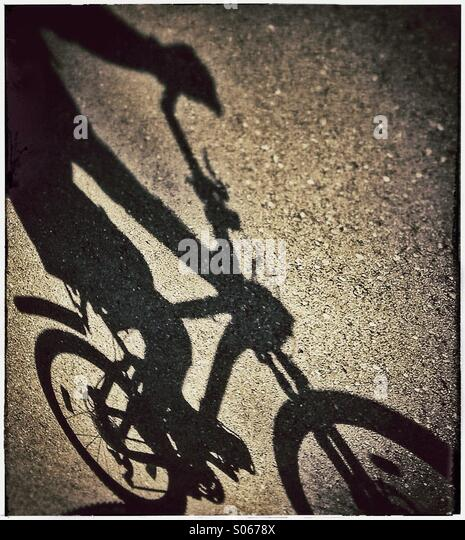shadow-of-somebody-riding-a-bicycle-s067