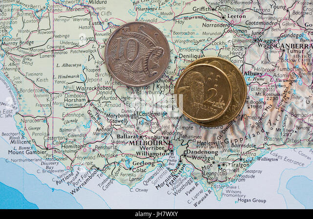 map of australia with australian coins stock image