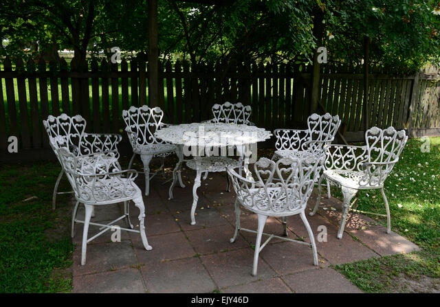 Sheltered garden stock photos sheltered garden stock for White wrought iron furniture