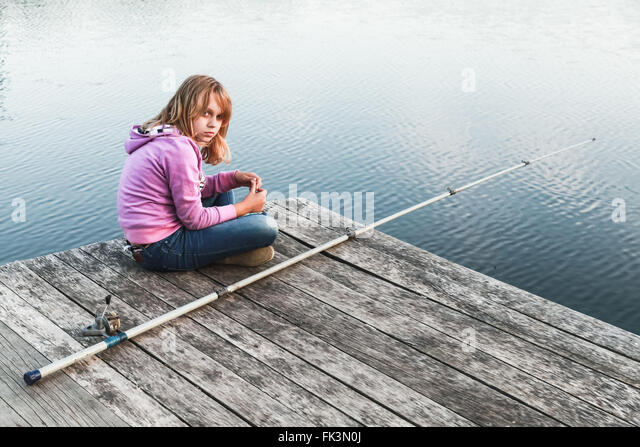 Teenager fishing lake stock photos teenager fishing lake for Girl fishing pole