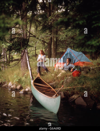 1970s COUPLE AT A FOREST CAMP CAMPSITE WITH TENT AND CANOE IN STREAM - Stock Image & Tents 1970s Stock Photos u0026 Tents 1970s Stock Images - Alamy
