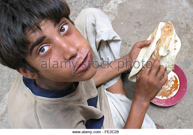 Afghan boy enjoys his meal distributed by a <b>charity cafe</b> in Karachi on ... - afghan-boy-enjoys-his-meal-distributed-by-a-charity-cafe-in-karachi-fe2c28