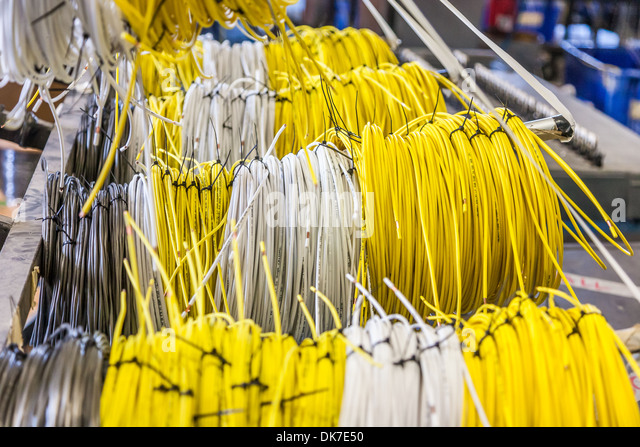 spools of wire labeled for installation in wiring harness at tiffin dk7e50 wiring harness stock photos & wiring harness stock images alamy Wire Harness Assembly at virtualis.co