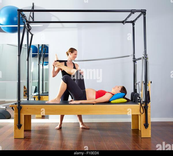 Woman Pilates Chair Exercises Fitness Stock Photo: Leg Stretch Machine Stock Photos & Leg Stretch Machine