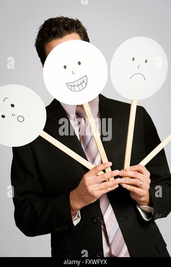 the person behind the smiling mask Curling black eyebrows and moustachios sit on a smiling white face, and  and  the mask is styled after guy fawkes, one of the ringleaders of.