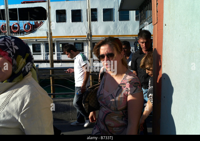 30 June 2008 A Young Modern Turkish Woman Disembarks From A Ferry In  Istanbul In Turkey