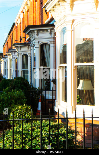 Terrace houses housing homes bay windows in Louth town Lincolnshire England  UK GB - Stock Image