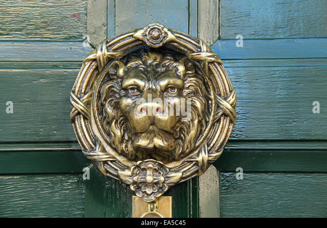 A Large Brass Lion Face Design Door Knocker. - Stock Image - Brass Door Knocker Lion Face Stock Photos & Brass Door Knocker