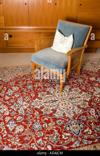 A Chair On Persian Rug In Living Room