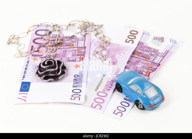 500 Euro bank notes, car and jewelry. Concept of consumerism and money spending - Stock Image