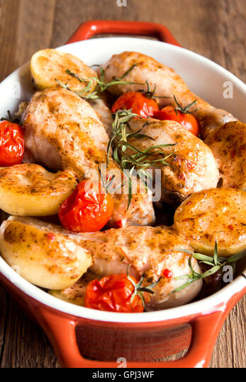 how to cook chicken legs in the oven with potatoes