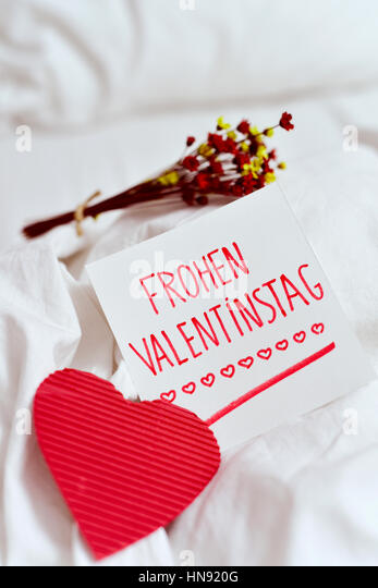 Closeup Of A Red Heart, A White Paper Note With The Text Frohen Valentinstag ,