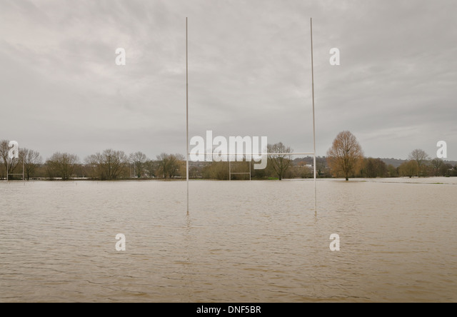 Flooded playing fields footpath in flood plane at Tonbridge School as ...