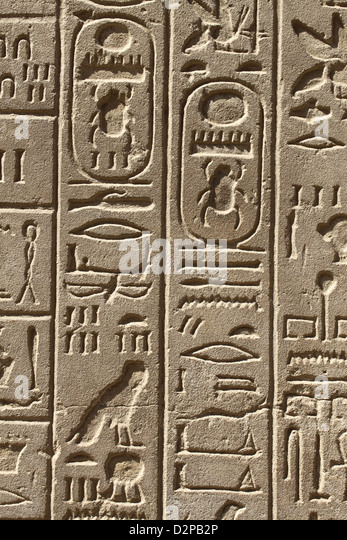 Ancient writing on stone stock photos