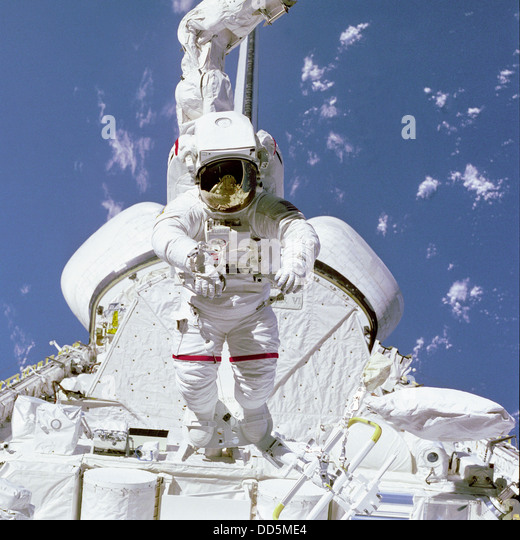 an astronaut goes out for a space walk - photo #27