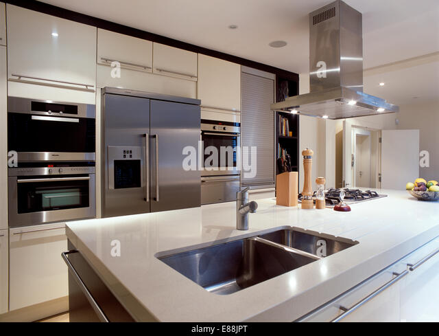 Interiors Modern Kitchens Refrigerators Stock Photos  : steel extractor fan above island unit with underset double steel sinks e88jpt from www.alamy.com size 640 x 489 jpeg 69kB