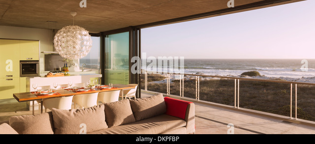 Modern Living Room And Dining Overlooking Ocean