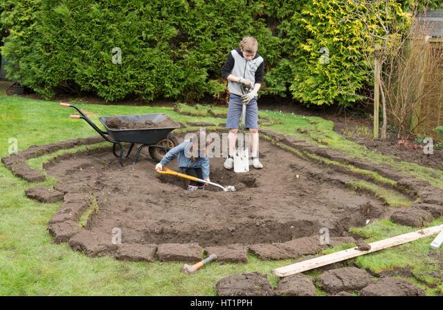 Children Digging Hole Stock Photos Children Digging Hole