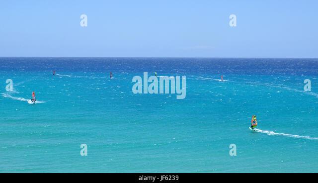 Wind Surfing in the Atlantic ocean near Costa Calma on Fuerteventura canary island in Spain - Stock Image