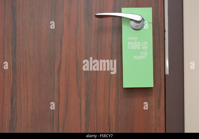 please lock door. Please Make Up My Room Sign On Door Knob In Hotel - Stock Image Lock