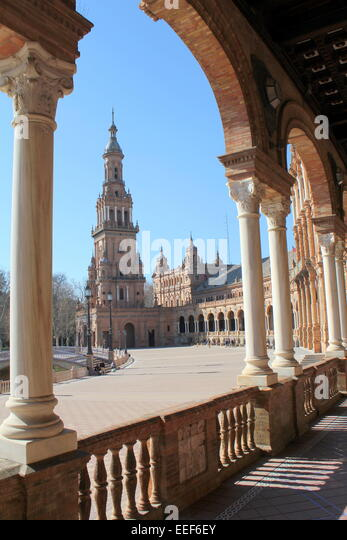 colonnade with arch framing the tall south tower at sevilles plaza de espaa spain square