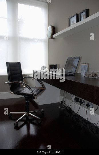 Chairs Modern Chrome Leather Stock Photos amp Chairs Modern  : black leather and chrome swivel chair in modern home office with laptop cefxme from www.alamy.com size 346 x 540 jpeg 32kB