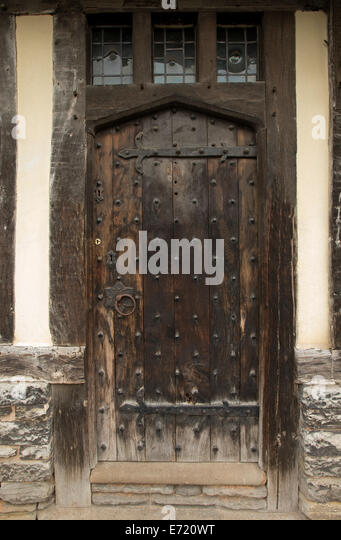 Old brown weathered wooden door with metal studs and ornate hinges - on historic building in & Metal Studs In Door Stock Photos u0026 Metal Studs In Door Stock ... pezcame.com